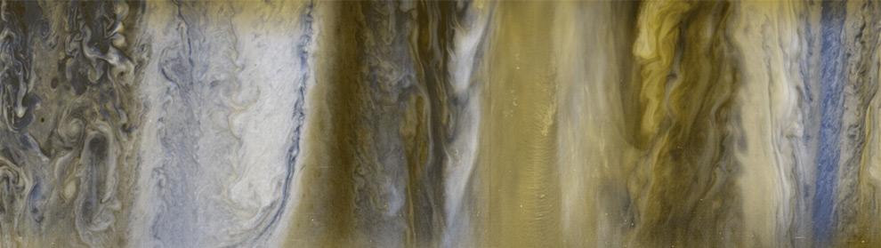 Una composizione di immagini prese dalla sonda New Horizon che mostra le varie componenti dell'atomsfera di Giove